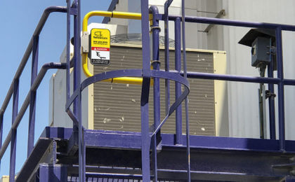 YellowGate placed on blue safety ladder for safe AC Unit access
